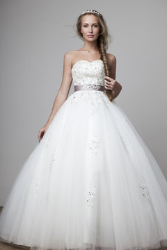 beautiful smiling girl in a white wedding dress