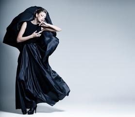 fine art fashion photo of beautiful woman model in elegant dress