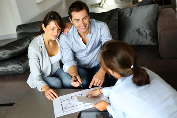 Couple signing financial terms for future property