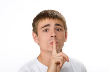 Man gesturing quiet. Top Secret