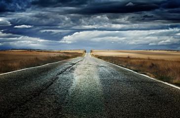 Old dramatic asphalt road