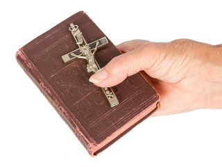 Old hand (woman) holding a very old bible