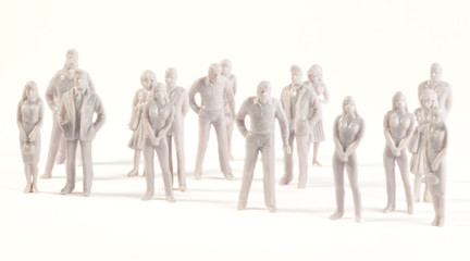 Miniature monochrome figures of human