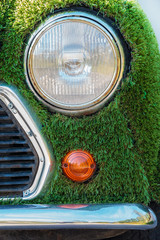 Eco car covered with artificial green grass
