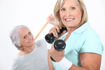Two middle aged women working out.