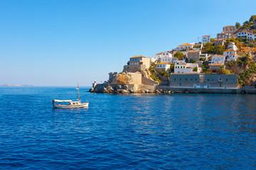 Wooden boat entering Hydra island in Saronikos gulf in Greece