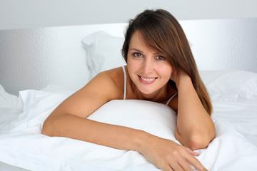 Portrait of beautiful woman laying in bed