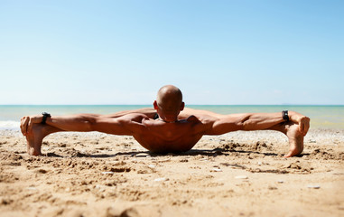 Man in strong stretching yoga pose