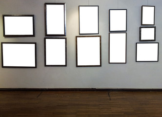 Empty photo frames on gallery wall