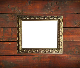 Antique golden frame on wooden wall