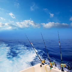 boat fishing trolling in deep blue ocean offshore