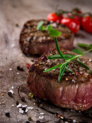Grilled bbq steak on wooden background