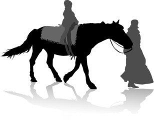 girl on the horse and the women walk near