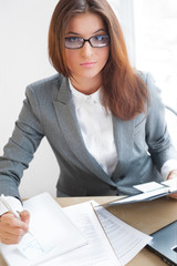 Beautiful young business woman wearing glasses sitting relaxed a