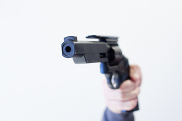 handgun pointed at camera