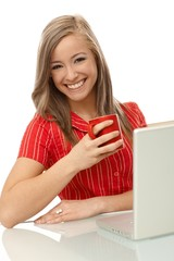 Beautiful woman with tea and laptop