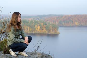 Beauty teen enjoy the autumn's lake view