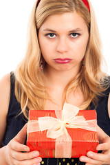Disappointed woman with gift