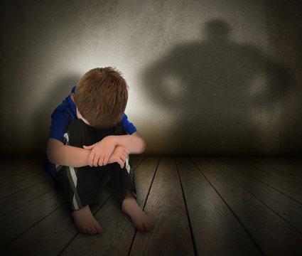 Sad Abused Boy with Anger Shadow