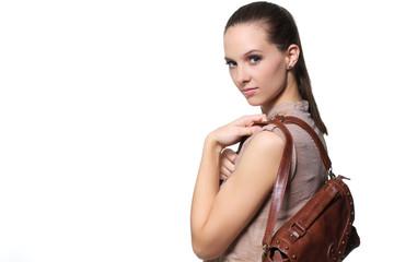 Woman wearing a handbag over the shoulder.