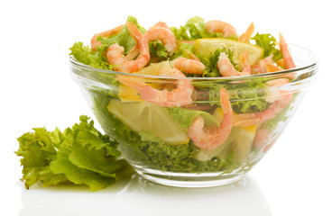 salad with shrimps, lemon and lettuce leaves in bowl, isolated