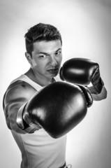 Muscular man boxing