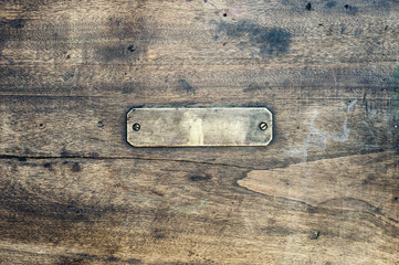 Wooden background with metal label