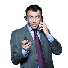 businessman surprised busy with multiple telephone