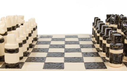 Unique handmade chess set (pottery), isolated