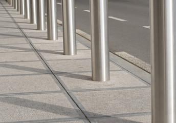 Road borders as urban background in metal tones