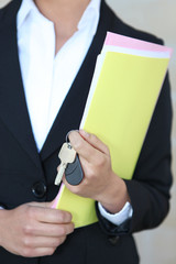 Businesswoman with files and keys