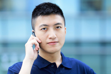 asian man with cell phone