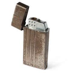Old cigarette-lighter on a white background