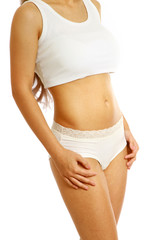 Closeup of a slim female body, isolated on white