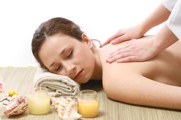 A woman getting a  massage, lying