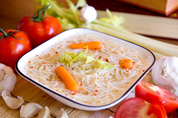 Chicken soup with cook books and vegetable