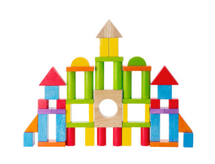 Colorful wooden toy castle on white