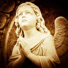 Praying angel in sepia shades