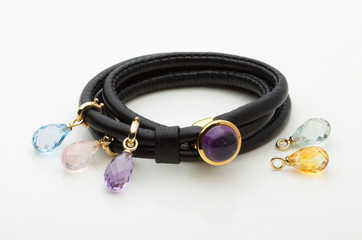 Leather bracelet decorated by beautiful gemstones