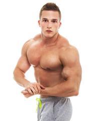 Muscular male bodybuilder, studio shot