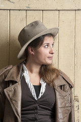 woman in cowboy coat and hat