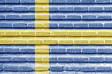 Sweden flag on an old brick wall