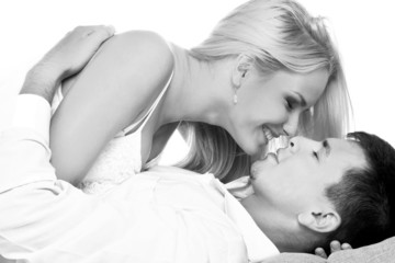 Black and white shot of young couple in love kissing