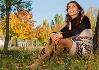 Young woman relaxing in the autumn park