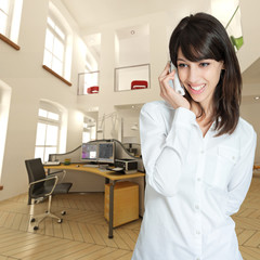 Woman on the phone at the office
