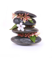 spa stones with white flower isolated on white