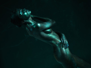 artistic nude of woman shiny blue skin