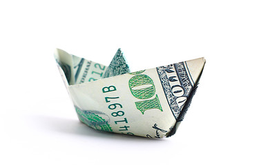 Hundred dollar banknote folded as a boat, finance