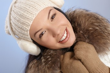 Winter portrait of beautiful smiling woman