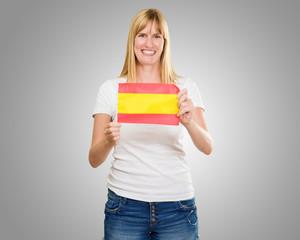 Happy Woman Holding Spanish Flag